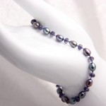 Iolite and Freshwater Pearls on Blue Silk