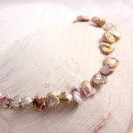 Mauve Freshwater Keishi Pearls on pink silk