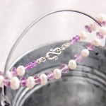 White Freshwater Pearls and Amethyst Rondelles on White Silk