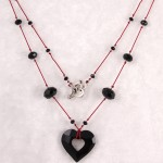 Jet Black Miss U Heart Pendant on Red Silk